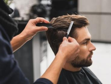 CBD-Style Cut with Towel Treatment ($15) or Fade Style Cut with Towel Treatment ($25) at Caveman Barbers