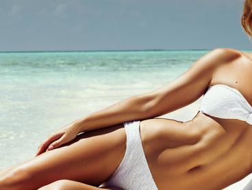 Get One Full Body Spray Tan and Body Polish Package for $30, or Two Packages for $55 (Valued Up To $130)