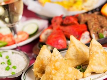Three-Course Indian Feast with Glass of Wine for Two ($39) or Four People ($78) at Dosa Hub (Up to $164.40 Value)