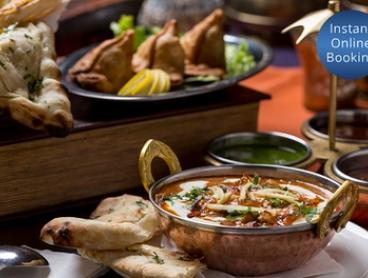 Three-Course Indian Feast with Wine for Two ($55) or Four People ($110) at Zinger Taj (Up to $203.20 Value)