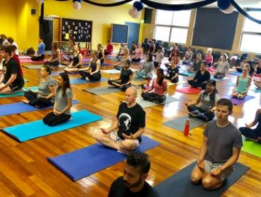 Two-Month Unlimited Yoga for One ($35) or Two People ($69) at Yoga School of India, 2 Locations (Up to $320 Value)