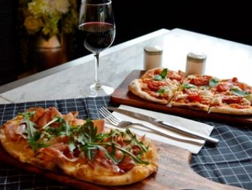 Woodfired Flatbread with Potato Bites and House Wine or Beer or beverage at Woodfired Kitchen (Up to $64 Value)