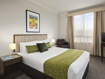 North Ryde, NSW: 1 or 2 Nights for Two People with Late Check-Out, Wine and Chocolates at 4* Quest Serviced Apartments