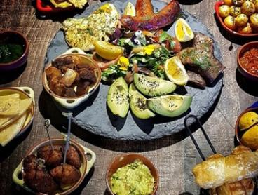 14-Dish Colombian Tasting Banquet + Wine for 2 ($39), 4 ($78) or 6 Ppl ($117) at Aluna Restaurant (Up to $233.70 Value)
