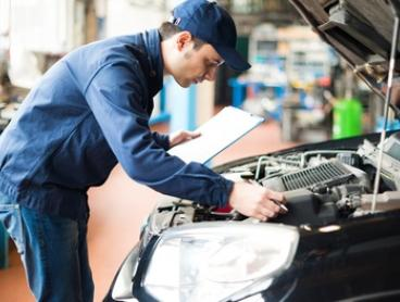 $55 for Car Service with Wheel Alignment and Pink Slip at City Garage (Up to $527 Value)