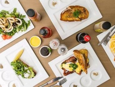 Breakfast or Lunch with Drink: One ($13), Two ($26) or Four People ($52) at Addiction Food and Coffee House (Up to $110)