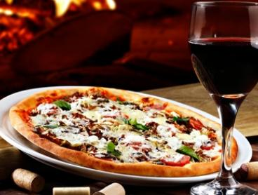 Pizza or Pasta with Garlic Bread and Wine for Two ($28) or Four People ($56) at Bambino Torino (Up to $103.70 Value)