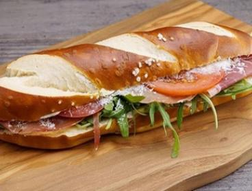 Pretzel Sub Sandwich with Drink: One ($5.50) or Two Sets ($11) at Bäckerei (Up to $19 Value)