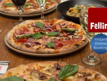 Three-Course Italian Meal with Wine for Two ($42) or Four People ($79) at Cafe Fellini (Up to $189 Value)