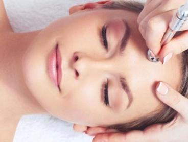 Microdermabrasion and Enzyme Peel: One ($49) or Two Sessions ($89) at Skinn Beauty Bar  (Up to $418 Value)