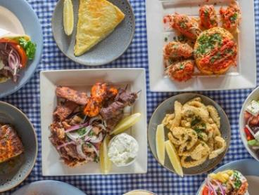 Greek Feast with Wine for 2 ($50), 4 ($100), 6 ($150) or 8 People ($200) at Meltemi Greek Tavern (Up to $446 Value)